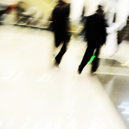 moving activity: Blur motion of businesspeople walking together.