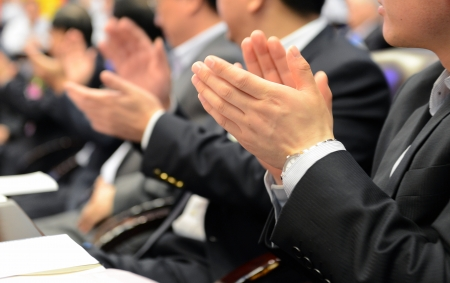 people clapping: Business people hands applauding at meeting.