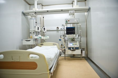 sickroom: A hospital bed waiting the next patient.