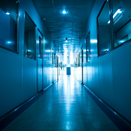 Empty long corridor in hospital. Stock Photo - 23975414