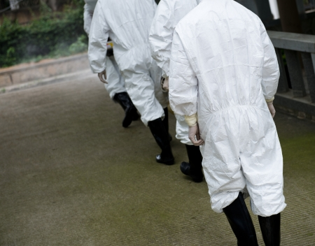 lab coat: medical worker wearing a gas mask and a lab coat.