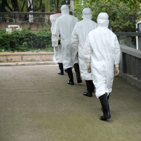 malaria: medical worker wearing a gas mask and a lab coat.