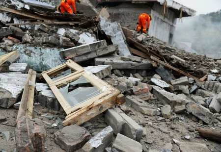 disaster recovery: Search and rescue forces search through a destroyed building. Stock Photo