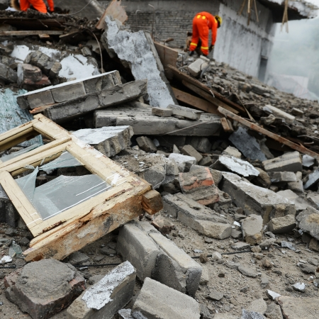 Search and rescue forces search through a destroyed building. Stock Photo