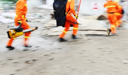 Search and rescue forces search through a destroyed building. blur motion