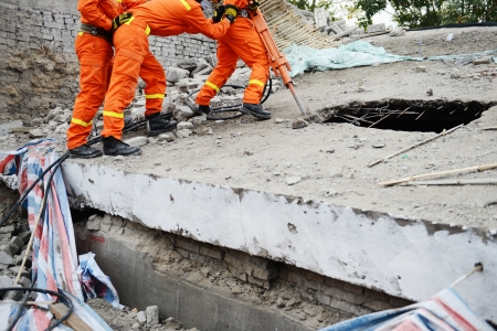 recovery: Search and rescue forces search through a destroyed building. Stock Photo