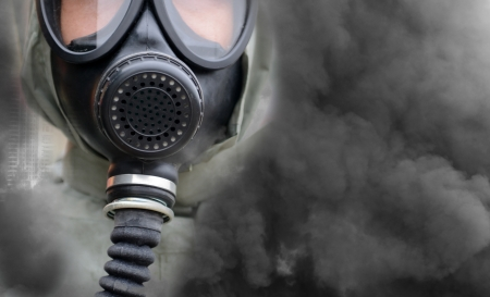 bizarre: A man in a gas mask.