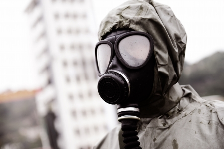 gas mask: A man in a gas mask.