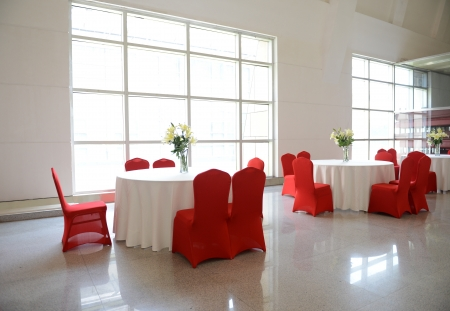 dining table and chairs: gorgeous red chairs and white table setting for fine dining.