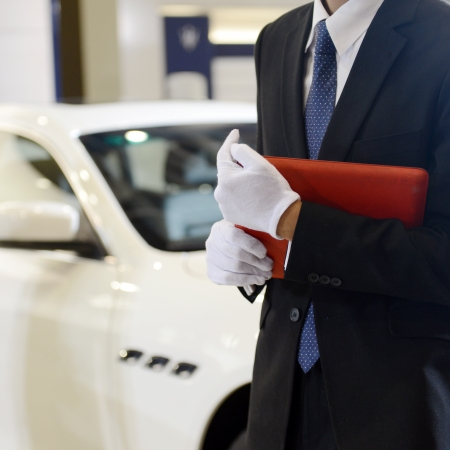 Car seller with car in a motor show.
