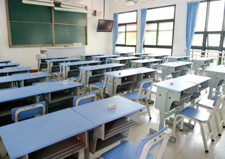 Empty classroom with chairs, desks.