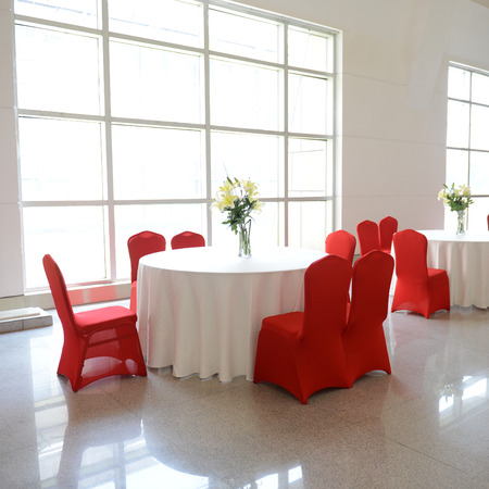 gorgeous red chairs and white table setting for fine dining. photo