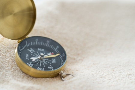 Vintage compass on the sand.