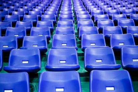 Rows of blue stadium seats with numbers.