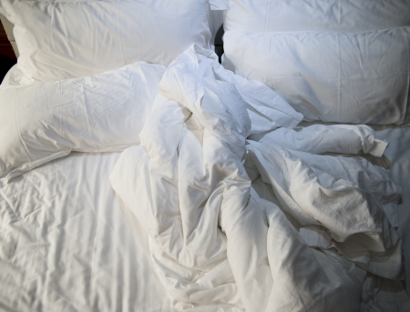 rumpled: close up of messy bedding sheets and pillow Stock Photo