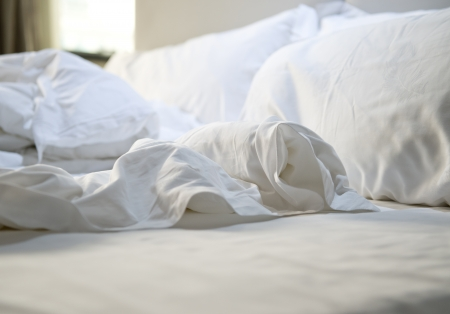 bedclothes: close up of messy bedding sheets and pillow Stock Photo