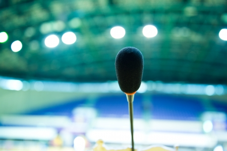 public speaking: Close up of microphone in auditorium.