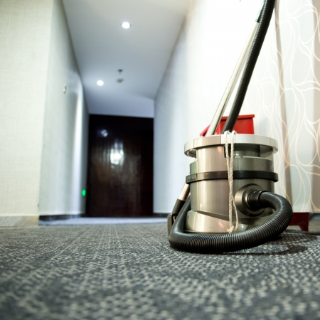 clean commercial: vacuum cleaner stands in the hotel corridor.