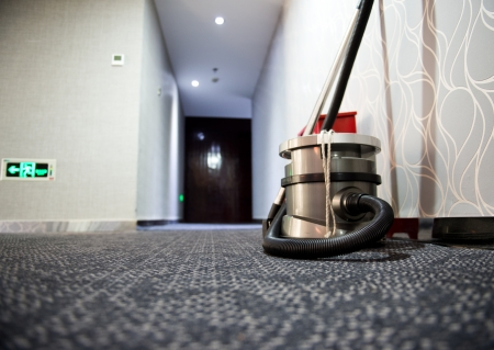 commercial: vacuum cleaner stands in the hotel corridor.