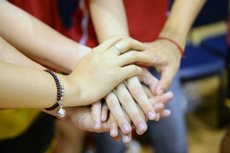 many hands: team of friends showing unity with their hands together Stock Photo