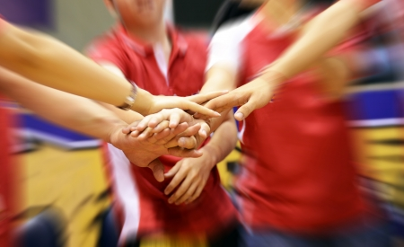team of friends showing unity with their hands together Standard-Bild