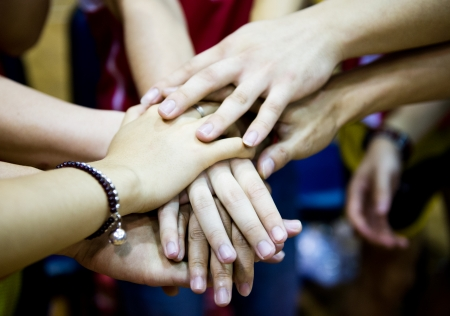 jointly: team of friends showing unity with their hands together Stock Photo