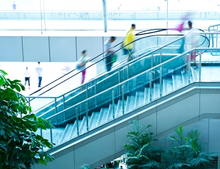 people in elevator: People rush on escalator motion blurred. Stock Photo