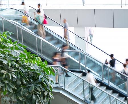 blur subway: People rush on escalator motion blurred. Stock Photo