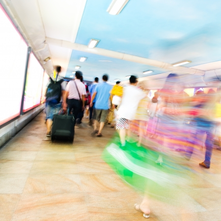 passenger walking in the subway station. blurred motion photo