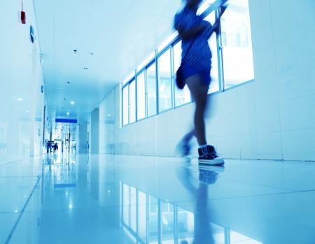 People walking through the hospital corridor. blurred motion
