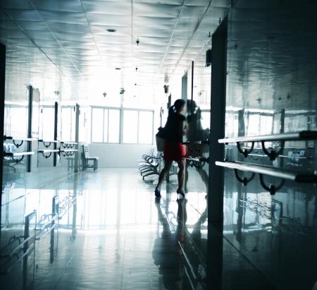 awe: People walking through the hospital corridor. blurred motion