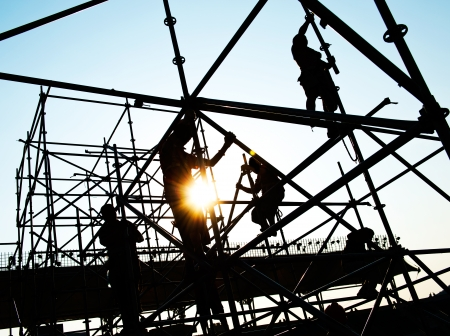 construction platform: Construction workers working on scaffolding
