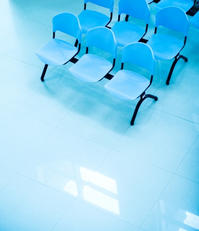 waiting area: Hospital waiting room with empty chairs.