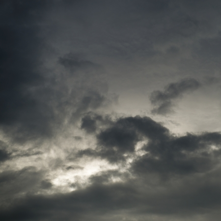 Background of dark clouds before a thunder-storm photo