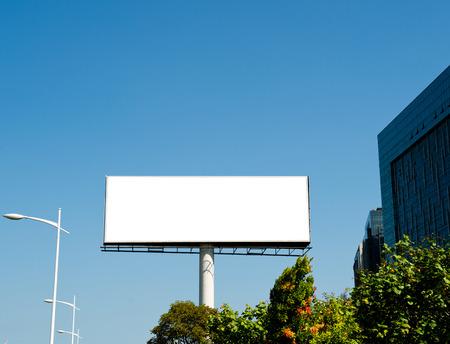 Blank billboard against blue sky. Banco de Imagens