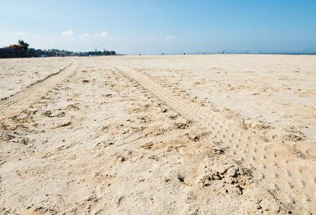 wheel tracks on the beach sand. photo