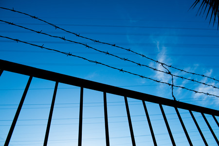 stockade: wire fence isolated on blue sky.
