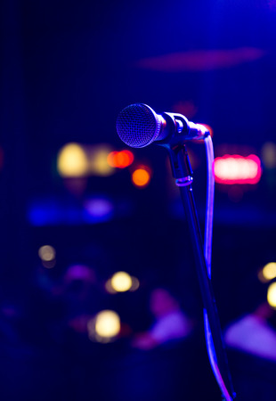 Close up of microphone in concert hall photo