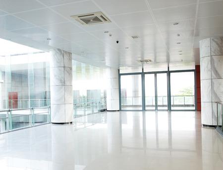 empty long corridor in the modern office building.
