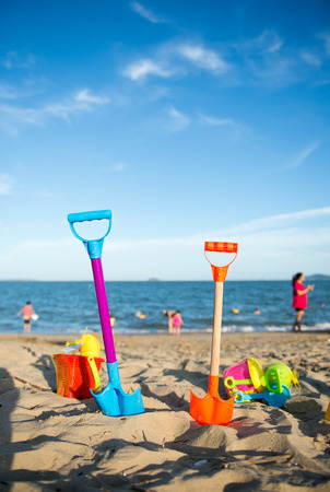 beach toys: Group of childrens beach toys on a sunny day.