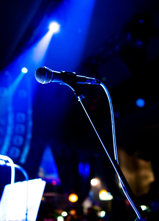 electronic music: Close up of microphone in concert hall Stock Photo