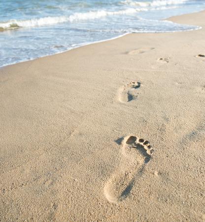 sea mark: Footprints on the sand beach