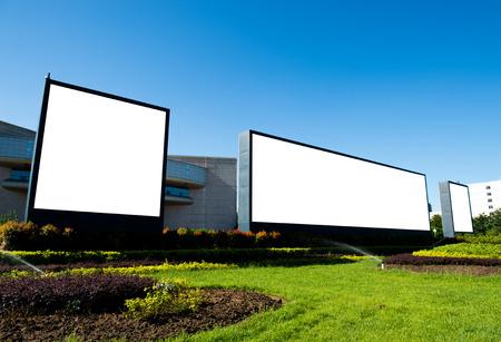 Blank billboard against blue sky.