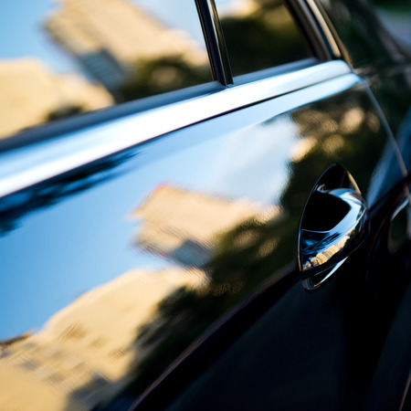 shiny black: The sunset is reflected  in the brand new car Stock Photo