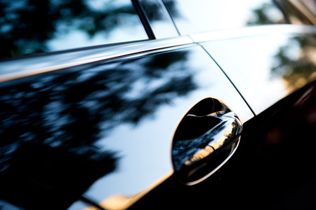 limo: The sunset is reflected  in the brand new car Stock Photo