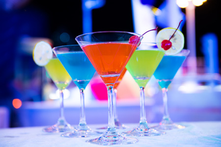 Group of colorful cocktail in martini glasses. photo