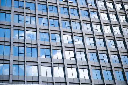 modern glass silhouettes on modern building. Stock Photo