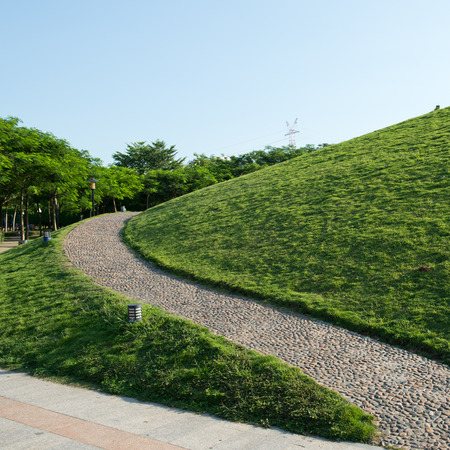 leading the way: Stone pathway through the rolling grassy hills.