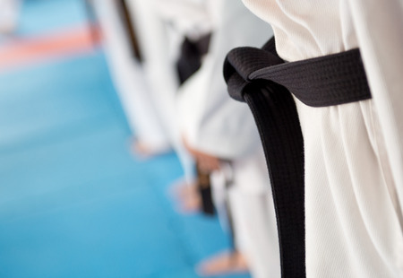 black belt: People in martial arts training exercising Taekwondo.