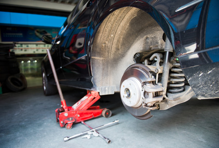 repaired: Car without tire need to be repaired.